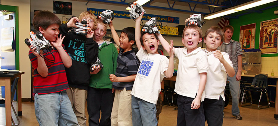 kids celebrating with robots